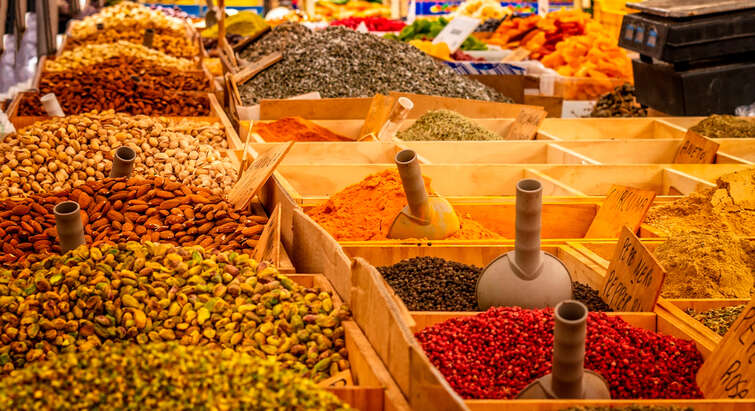 Picture of different spices and nuts at a food market